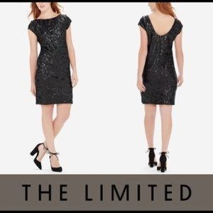 The limited black sequin shift dress